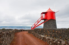 A windmill on island Pico Royalty Free Stock Images