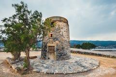Windmill on Kalydon Peninsula near Agios Nikolaos, Crete, Greece Stock Photos