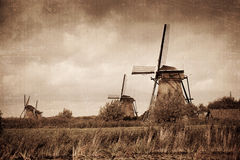 Windmill in Kinderdijk. Costs on the bank of the channel, Holland Stock Photo