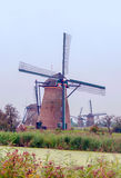 Windmill in Kinderdijk in vertical Stock Photo