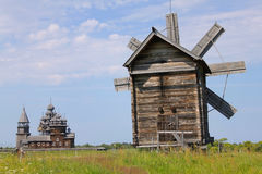 Windmill and Kizhi Pogost in Karelia, Russia Royalty Free Stock Image
