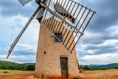 Windmill in La Couvertoirade a Medieval town in Aveyron, France royalty free stock photography