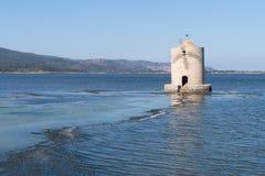 The windmill on the lagoon of Orbetello, Tuscany, Italy Stock Photography