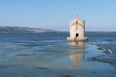 The windmill on the lagoon of Orbetello, Tuscany, Italy Royalty Free Stock Photography