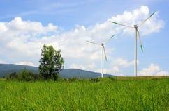 Windmill Landscape. Wind turbines in a field Royalty Free Stock Image