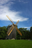Windmill landscape. Old example of an alternative energy generation - wooden windmill Stock Photography