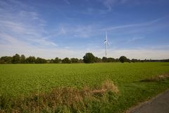 A windmill in a landscape picture stock photo
