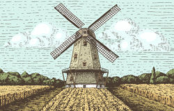 Windmill landscape in vintage, retro hand drawn or engraved style, can be use for bakery logo, wheat field with old Stock Photo