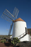Windmill, Lanzarote. Charmingly restored, conical-shaped, old windmill at the cactus garden, Lanzarote Royalty Free Stock Photo