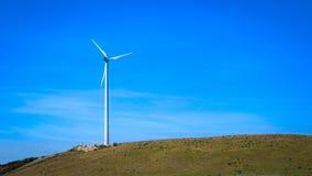 Windmill on lawn Stock Photo
