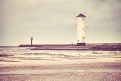Windmill lighthouse in Swinoujscie, Poland. Windmill lighthouse in Swinoujscie on a cloudy day, color toned picture, Poland Royalty Free Stock Photo