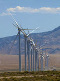Windmill lineup (2). Row of giant wind turbines being constructed in the desert near Milford, Utah Stock Photos