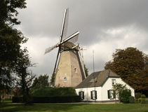 Windmill with little house Stock Images