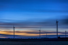 Windmill with Long Exposure Evning Cloudy Sky. Royalty Free Stock Photo