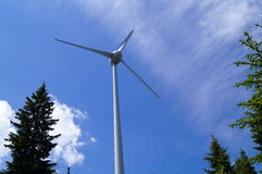 Windmill is a machine on blue sky. A wind turbine against a vivid blue sky Royalty Free Stock Photography