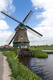Windmill. A windmill is a machine that converts the energy of wind into rotational energy by means of vanes called sails or blades.[1][2] The reason for the name Royalty Free Stock Photos