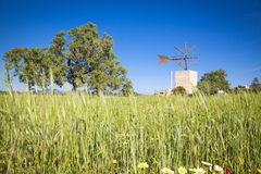 Windmill in Mallorca. Traditional old windmill of Mallorca Stock Photo