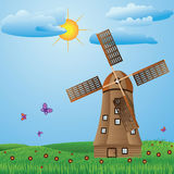 Windmill on meadow Stock Images