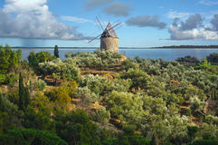 Windmill with Mediterranean sea in background Stock Photo