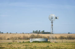 Windmill and Metallic Tank Horizontal Stock Photography