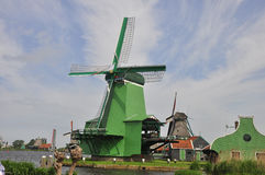 Windmill. A windmill is a mill that converts the energy of wind into rotational energy by means of vanes called sails or blades. Centuries ago, windmills usually Royalty Free Stock Images