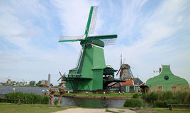 Windmill. A windmill is a mill that converts the energy of wind into rotational energy by means of vanes called sails or blades. Centuries ago, windmills usually Royalty Free Stock Photo