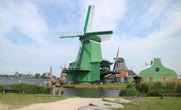 Windmill. A windmill is a mill that converts the energy of wind into rotational energy by means of vanes called sails or blades. Centuries ago, windmills usually Royalty Free Stock Photos