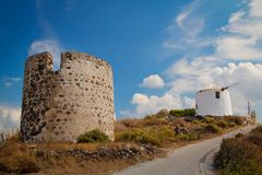 Windmill at Milos island Stock Photos