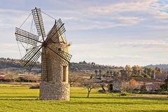Windmill in montuiri, farm, meadow,trees and beautiful hills, mallorca, spain royalty free stock photography