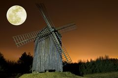 Windmill and moon Stock Images