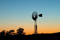 Windmill and Moon. At sunset Stock Image