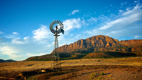 Windmill and Mountain Stock Images
