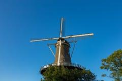 Windmill museum de Valk in Leiden. Windmill museum de Valk in a blue sky in Leiden the Netherlands Stock Images