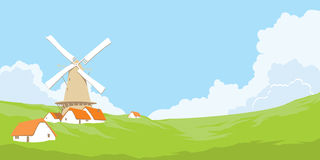 Windmill in nature. Windmill on the background of natural landscape Royalty Free Stock Photos