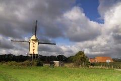 Windmill near Batenburg. Windmill on a dike along the river Maas near the Dutch village Batenburg Stock Images