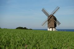 Windmill near the coast with view to the sea stock images