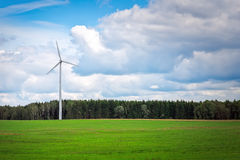 Windmill near of the green field. Stock Images
