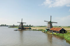 Windmill near the river at Zaanse Schans, Holland Royalty Free Stock Image