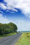 Windmill near a road Stock Photography