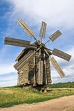 Windmill near road. Old historical obsolete windmill near country road in field Stock Images