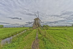 Windmill near the water canal in Netherlands Royalty Free Stock Photography