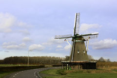 Dutch Windmill. Windmill of Windesheim, near Zwolle, Netherlands, built in 1748 and last renovated in 1952. This one is still in use to mill wheat into flower Royalty Free Stock Photos