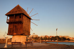 Windmill in Nessebar in morning sunrise time Royalty Free Stock Image