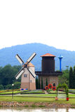 Windmill netherlands style in flower gar Royalty Free Stock Photo