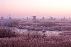 Windmill in the Netherlands at sunset Stock Image