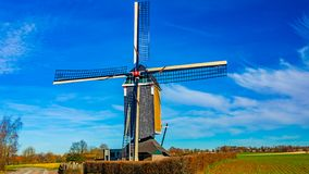 Windmill next a field on a wonderful sunny day. With few white clouds in Beek, south Limburg the Netherlands Holland stock image