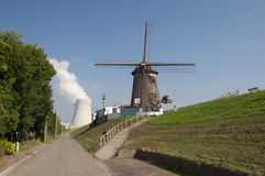 Windmill and nuclear power plant Royalty Free Stock Photo