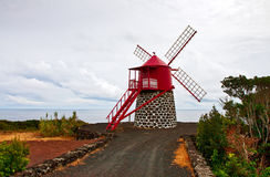 The windmill on the ocean Royalty Free Stock Photos