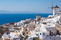 The Windmill in Oia and the Aegean Sea in Greece Royalty Free Stock Photo