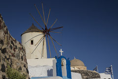 Windmill in Oia (Ia) town, Santorini - Greece Stock Photo